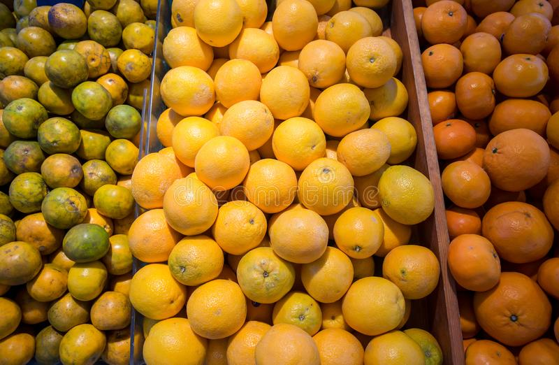 Many fresh and beautiful Oranges with a good taste in the basket at the market stock photography