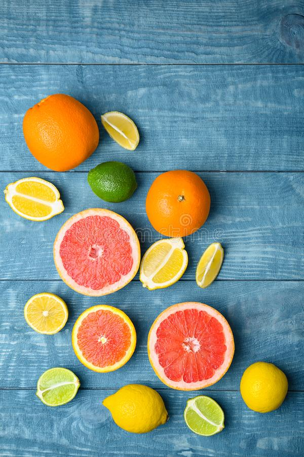 Many fresh citrus fruits. On wooden table stock photos