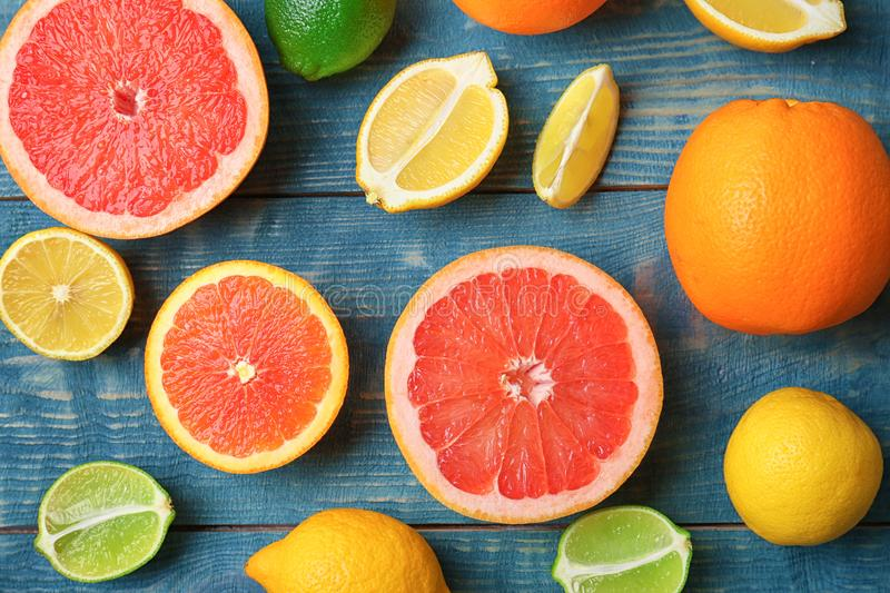 Many fresh citrus fruits. On wooden table stock photo