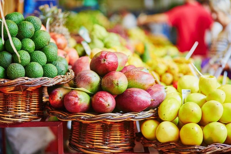Exotic fruits on farmer market in Funchal, Madeira, Portugal. Many fresh and ripe exotic fruits on traditional farmer market Mercado dos Lavradores, Funchal stock photos