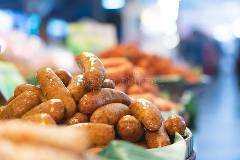 Many fried sausages on food streets in Thailand. stock photos