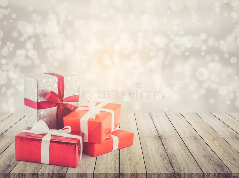 Many gift box with ribbon on wood table top bokeh white background royalty free stock photo
