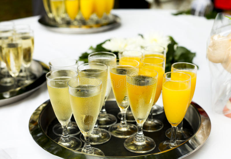 Many glases of champagner. Big silver tray with tequila royalty free stock photos