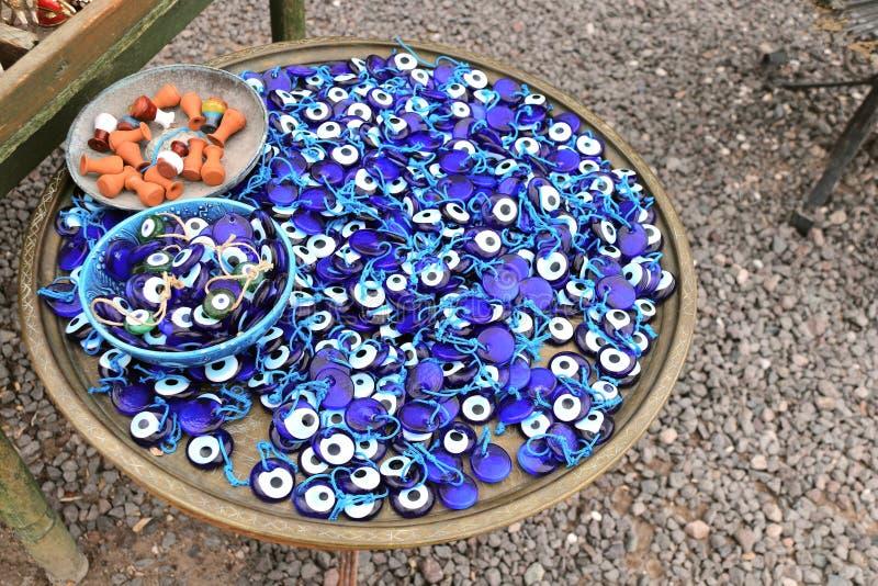 Evil eye charms, traditional turkish souvenirs, Turkey. Many glass mascots - evil eye charms, traditional turkish souvenirs, Turkey stock photos