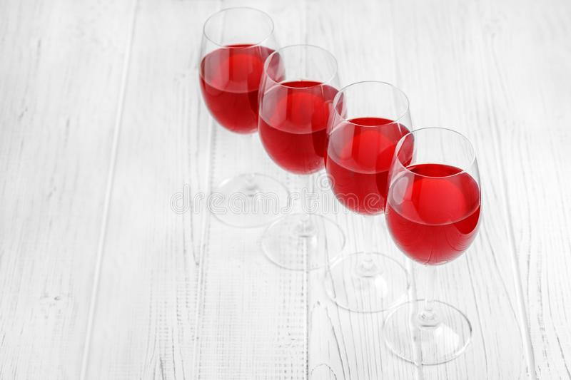Many glasses of burgundy French wine on a wooden table. Top view. Concept restaurant, alcohol, party stock photos