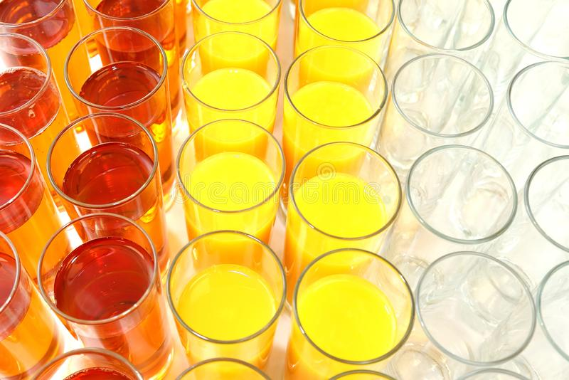 Many glasses with different juice. tableware for drinks stock image