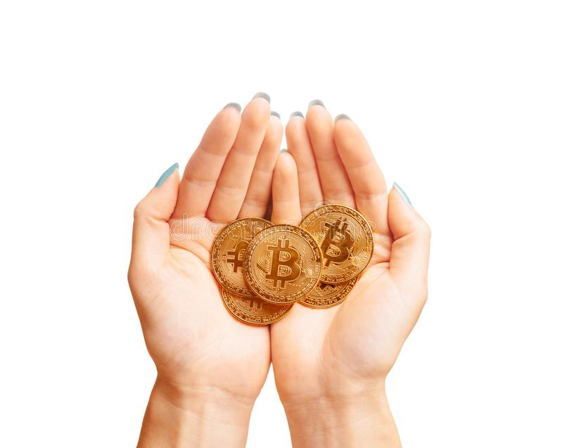 Many gold bitcoins coins in female hands. stock photos