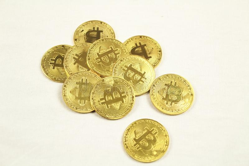 Golden bitcoins on white background royalty free stock photography