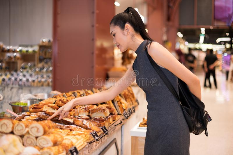 Many Good Looking design and colorful Bakery Cake. Many Good Looking design and colorful Bakery sandwich in refrigerator windows show, present variety of Price royalty free stock photo