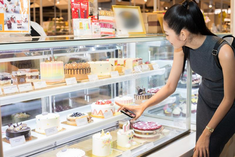 Many Good Looking design and colorful Bakery Cake. In refrigerator windows show, present variety of Price and vanilla chocolate birthday cake for special royalty free stock photo