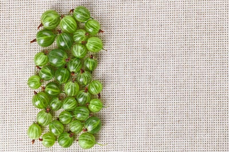 Many Gooseberry Fruits On Gray Linen Cloth Royalty Free Stock Image