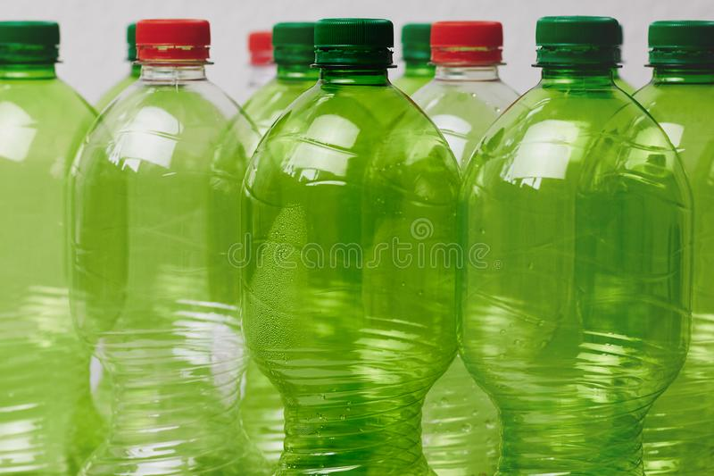 Many green plastic bottles with caps royalty free stock photography