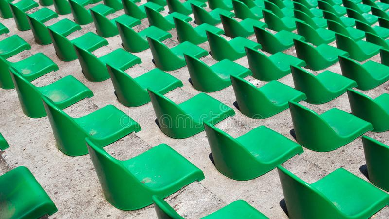 Many Seats in a Stadium. Many green plastic seats in rows in an empty stadium stock images
