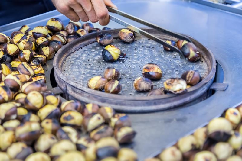 Many Grilled,roasted chestnuts for sale stock photo