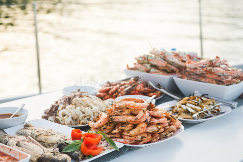 Many grilled seafood served buffet style in the restaurant. Food royalty free stock photo