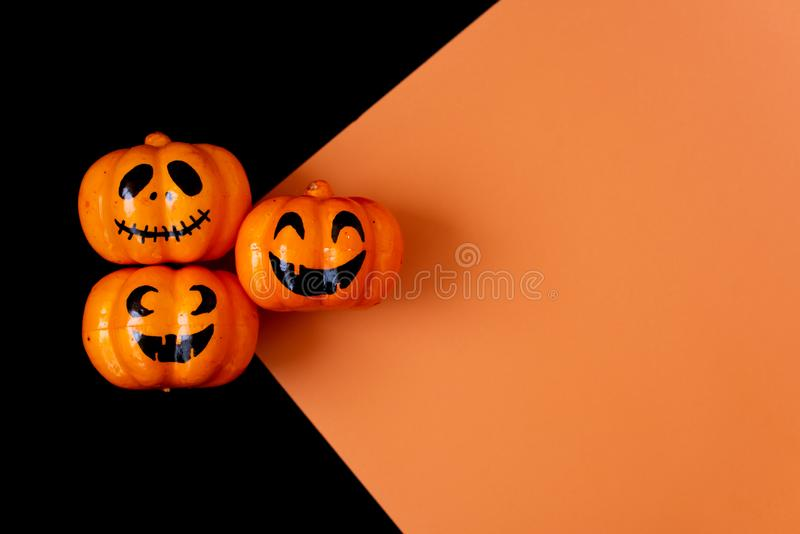 Many Halloween Pumpkins in a row on black background stock images