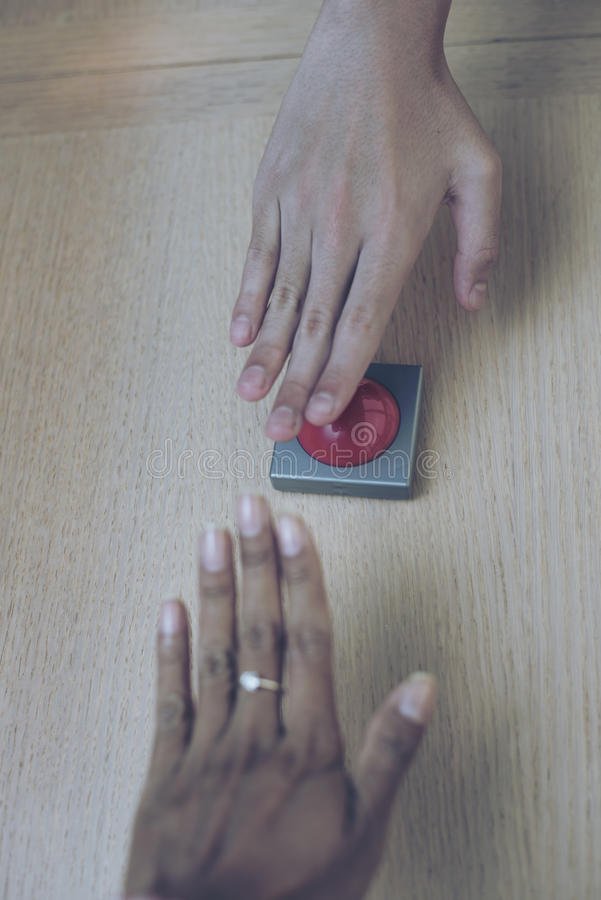 Free Many Hand Grab For The Red Button On Wood Table. Royalty Free Stock Photo - 79626125