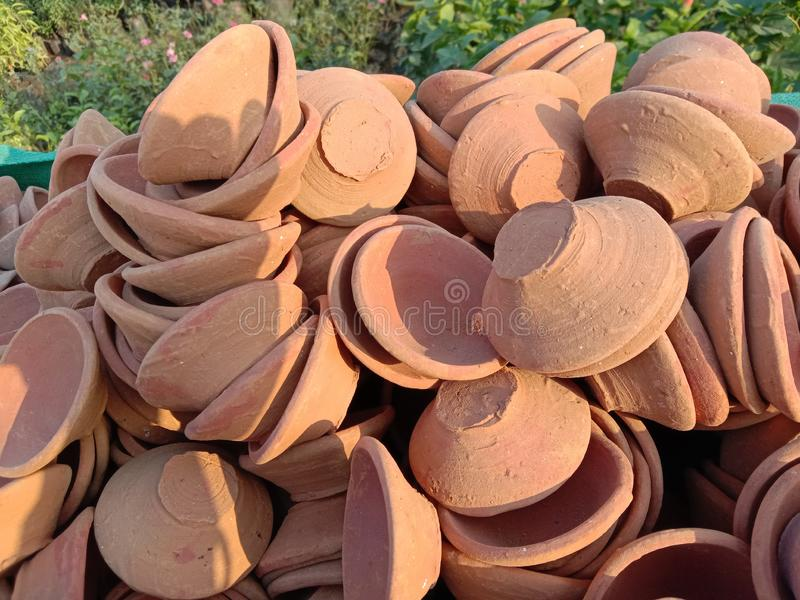 Many Handmade earthen lamps or clay for festival royalty free stock photos