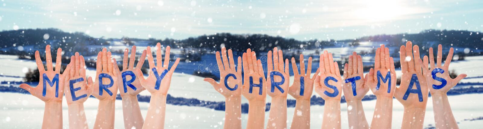 Many Hands Building Word Merry Christmas, Winter Scenery As Background. Many Hands Building English Word Merry Christmas. Beautiful Snowy Winter Landscape With royalty free stock photos