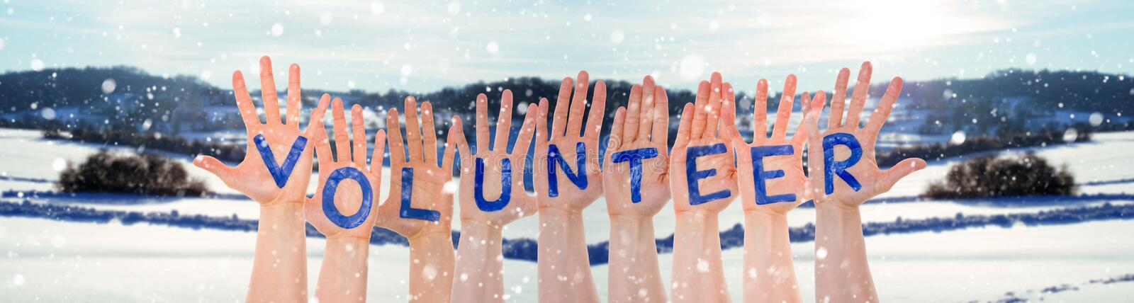 Many Hands Building Word Volunteer, Winter Scenery As Background. Many Hands Building English Word Volunteer. Beautiful Snowy Winter Landscape With Snow As royalty free stock photo