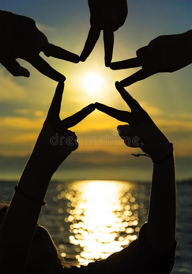 Free Many Hands Connecting To Star Shape At Sunset, Teamwork Concept Royalty Free Stock Images - 124429199