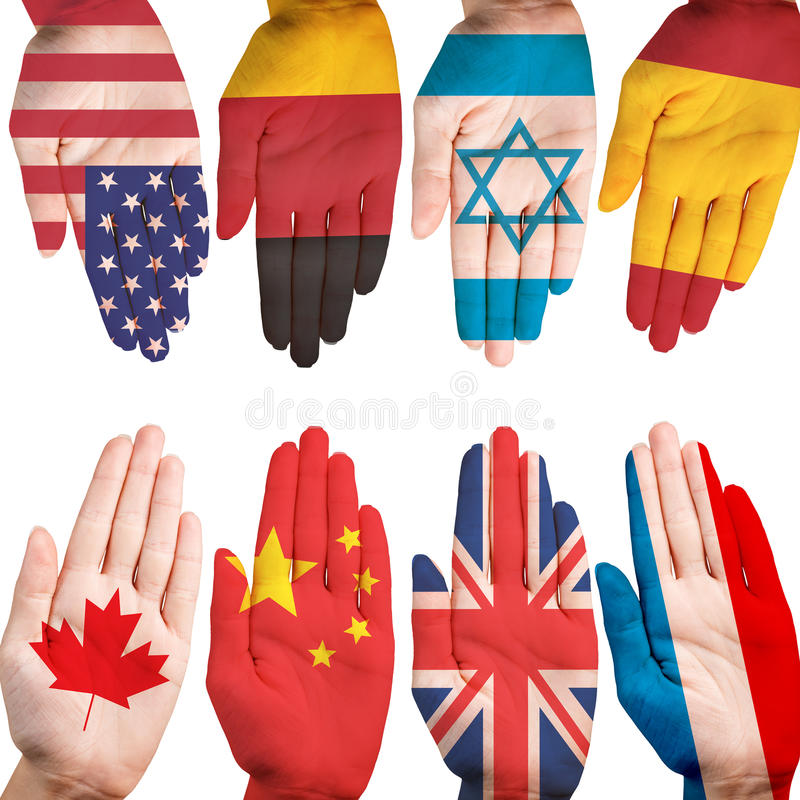 Many hands with different country flags. Painted on them isolated on white stock photo