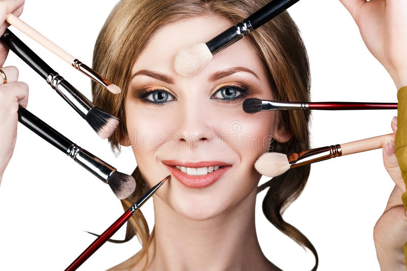 Many hands doing make up to glamour woman. royalty free stock image