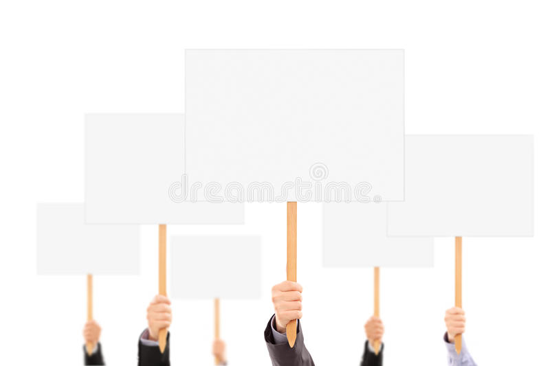 Many hands holding blank banners and signs stock photo
