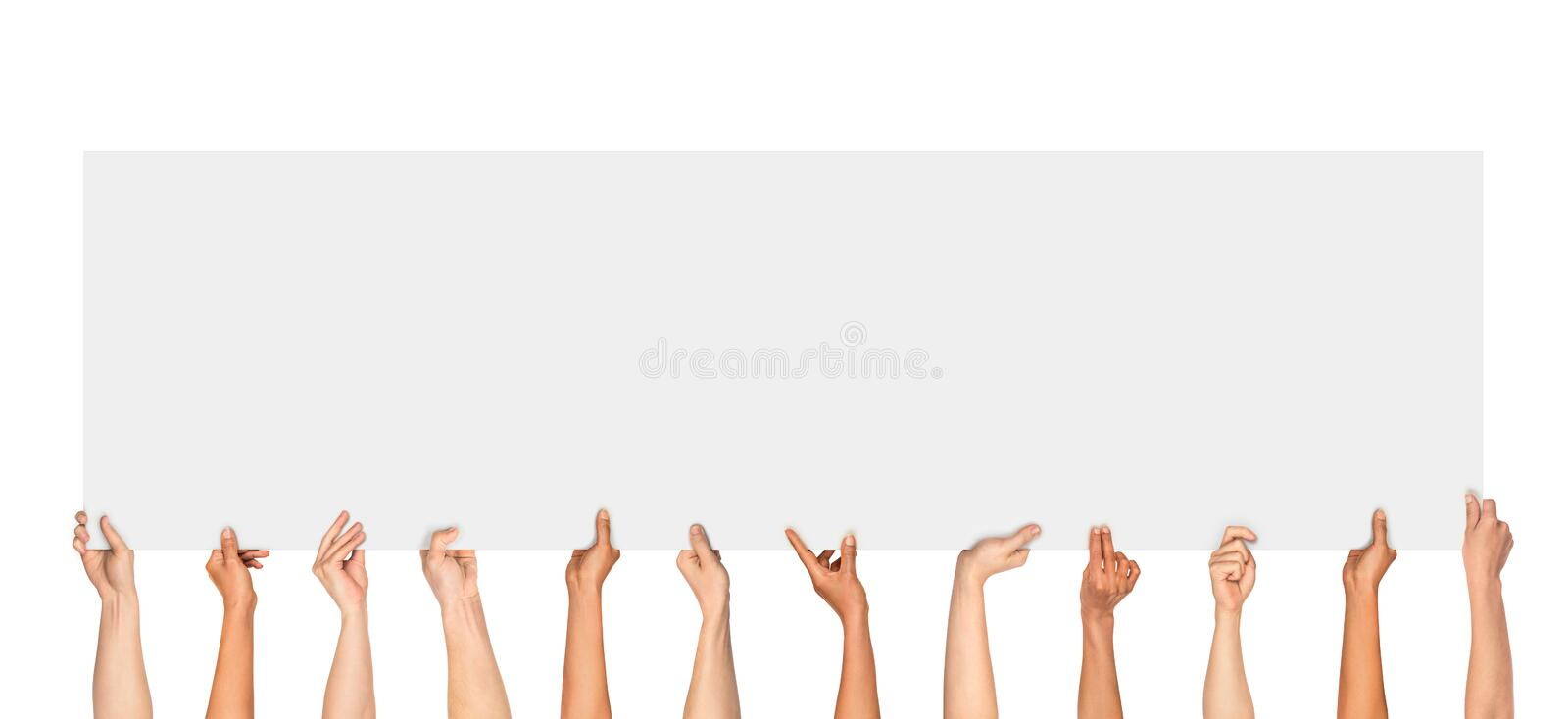 Many hands holding a blank poster for advertising stock image