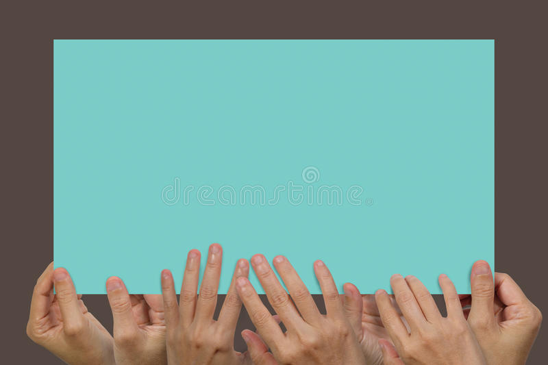 Many hands holding a white blank poster. For advertising on an isolated white background, concept and idea for business royalty free stock images