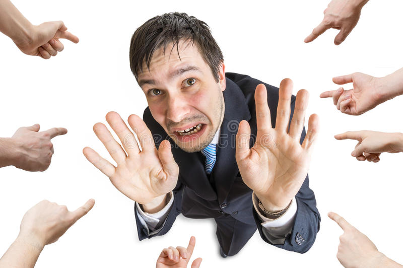 Many hands are pointing and blame stressed man. Isolated on white background. View from top stock images