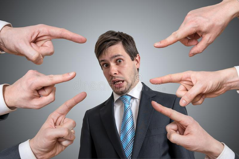 Many hands are pointing on guilty man and blame him. Many hands are pointing on guilty man and blame him stock photos