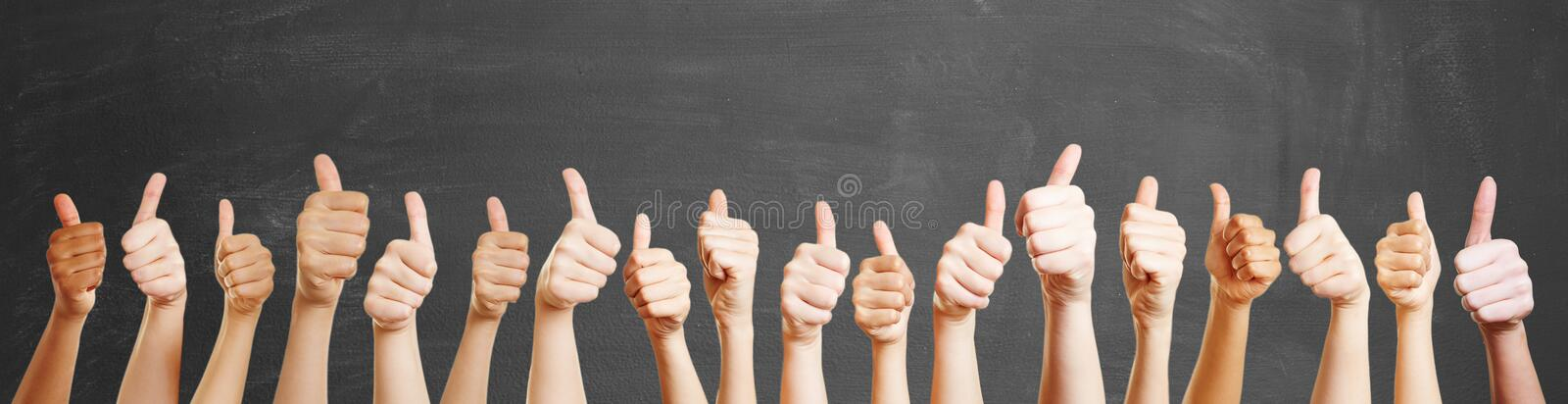 Many hands with thumbs up stock image
