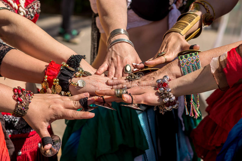 Many hands together showing unity royalty free stock photo