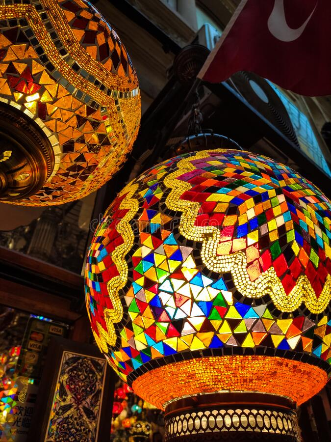 Many hanging and lit colourful and decorative Turkish glass light shades in a shop, Grand Bazaar, Istanbul, Turkey, Europe.  royalty free stock photo