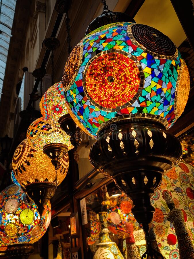 Many hanging and lit colourful and decorative Turkish glass light shades in a shop, Grand Bazaar, Istanbul, Turkey, Europe.  royalty free stock photos