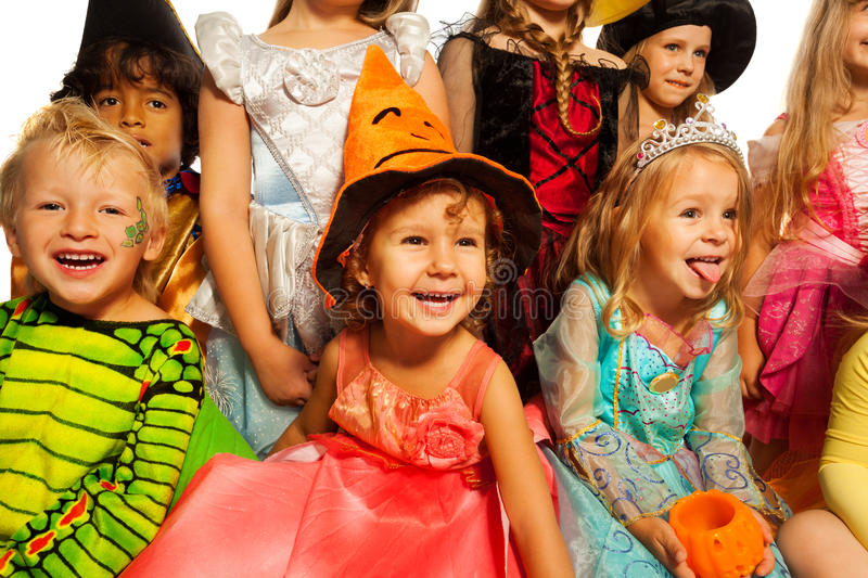 Many happy kids in Halloween costumes royalty free stock photo