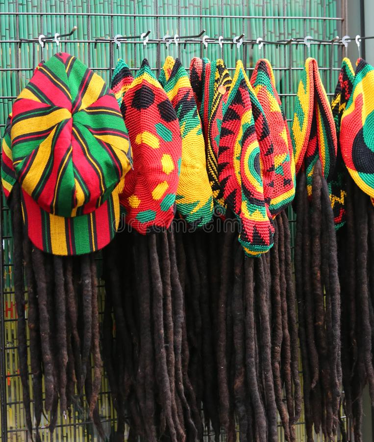 Hats with the colors of the Jamaican flag for sale in the costum. Many hats with the colors of the Jamaican flag for sale in the costume shop stock images
