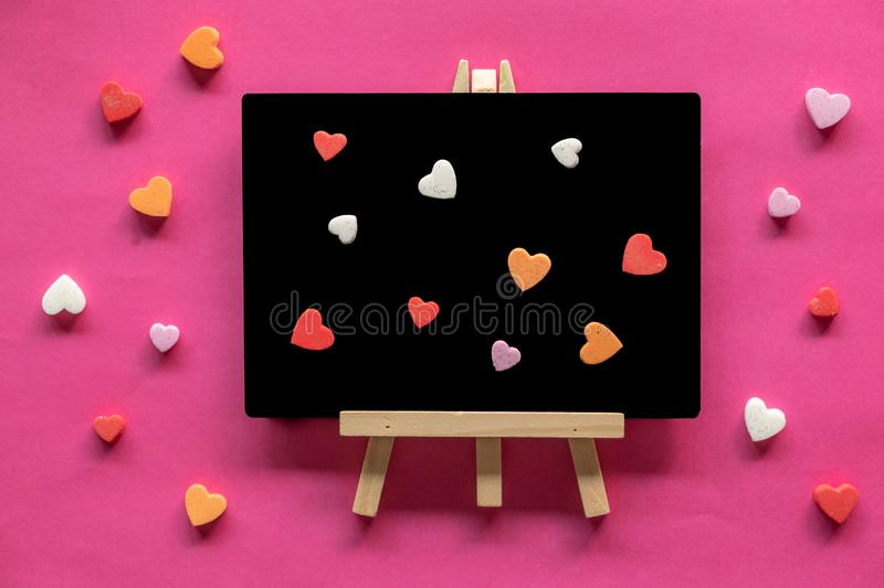 Many hearts with word LOVE on pink background, Love icon, valentine`s day, relationships concept. With copy space royalty free stock photos