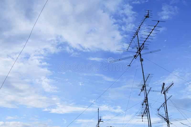 Many home TV antennas mounted on a roof. Many home TV antennas mounted on roof stock photos