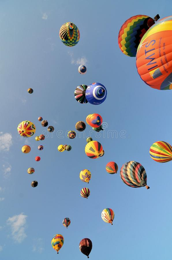 Many hot air balloons shortly after launching. Hot air balloons fill the sky over a festival in New Jersey shortly after launching. There are several styles stock photo