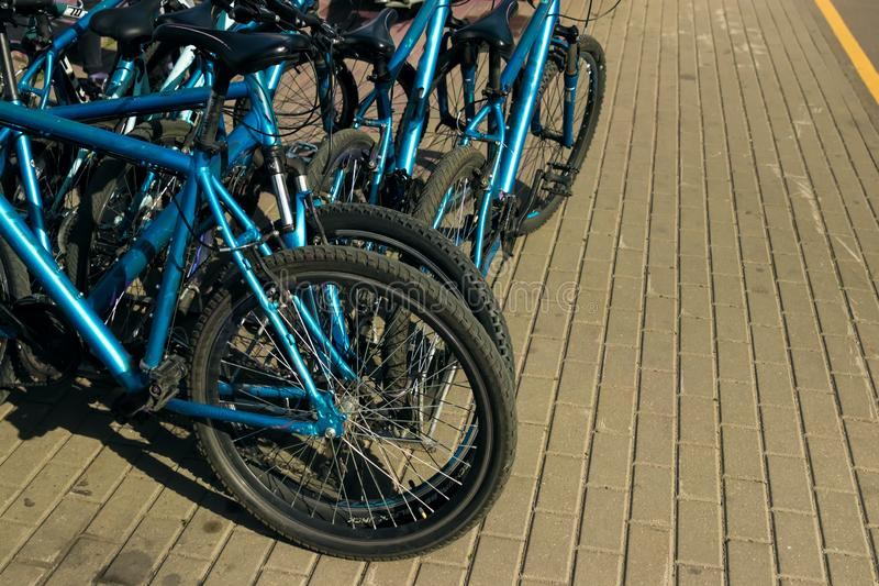Many identical bicycles in a row stock photos