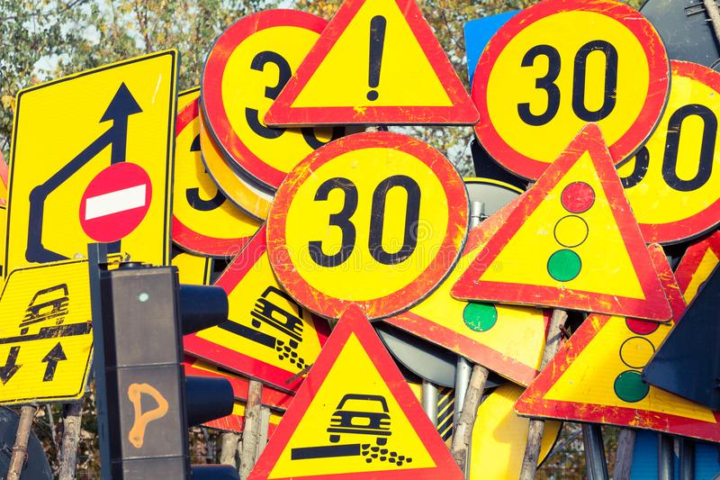Many industrial road signs stacked together stock images