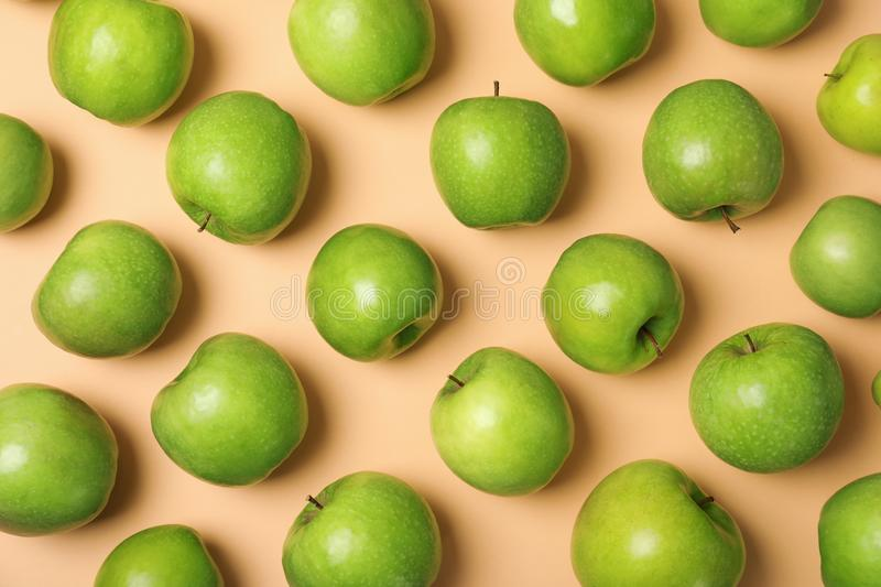 Many juicy green apples on color background. Top view royalty free stock photo