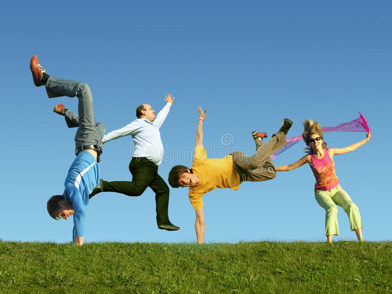 Many jumping people on the grass, collage stock photos