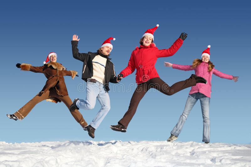Many jumping people on snow stock images