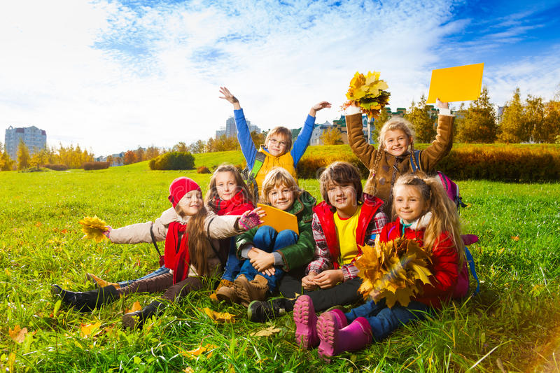 Download Many kids in autumn kids stock photo. Image of leaves - 35575470