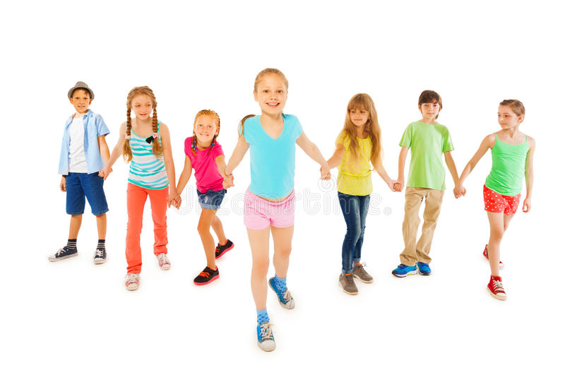 Many kids with happy little girl hold hands stock image