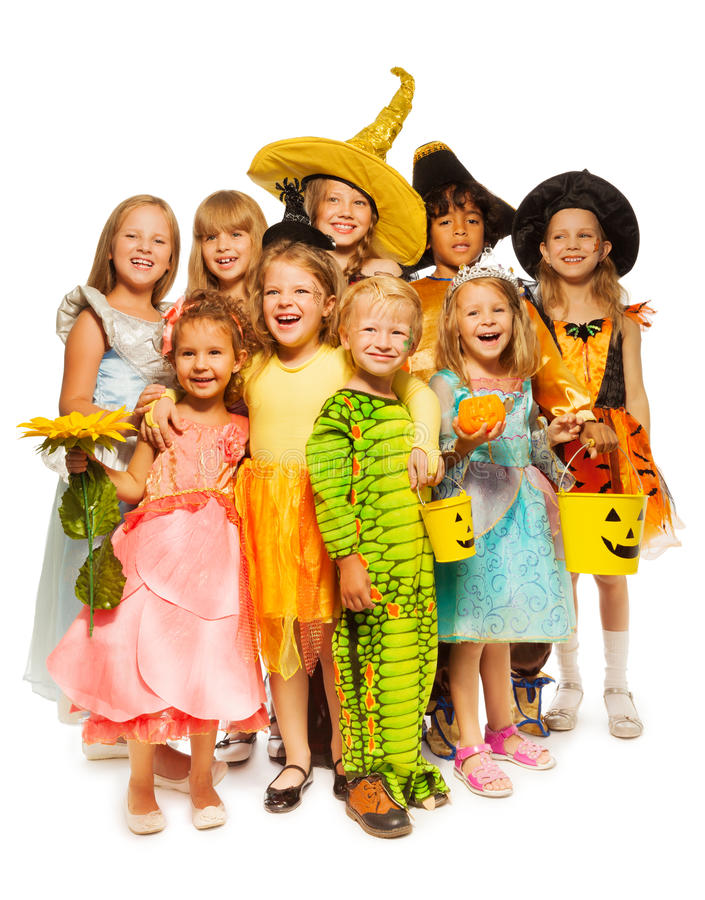 Many kids stand in Halloween costumes together stock photo