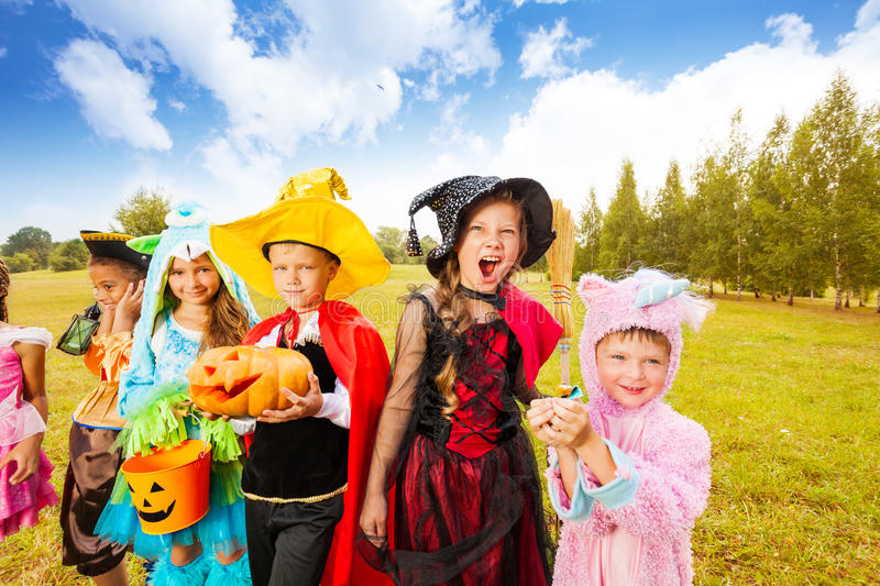 Many kids wear Halloween costumes in park stock photo